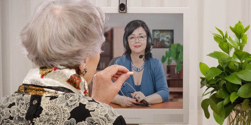 Senior speaking to physician on her computer.